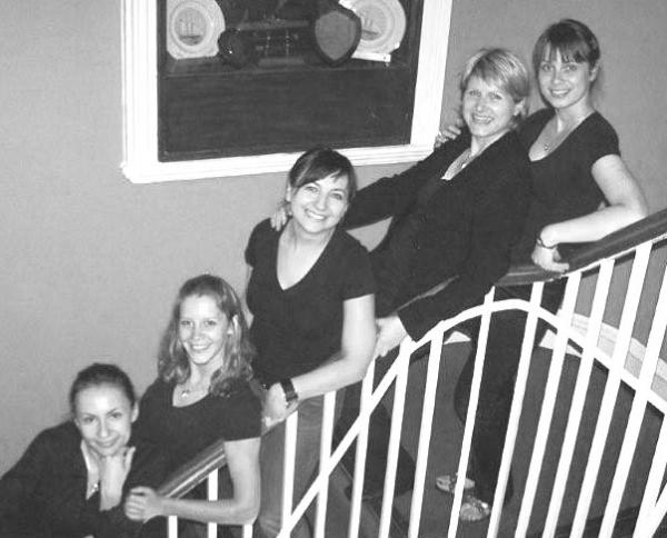 Happy staff on stairs
