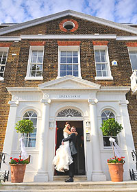 Bride and groom in front of Linden House. Photo by bespokeweddingphotography.co.uk